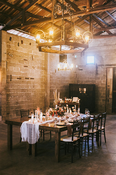wooden table and white linens and candles in the wine cellar