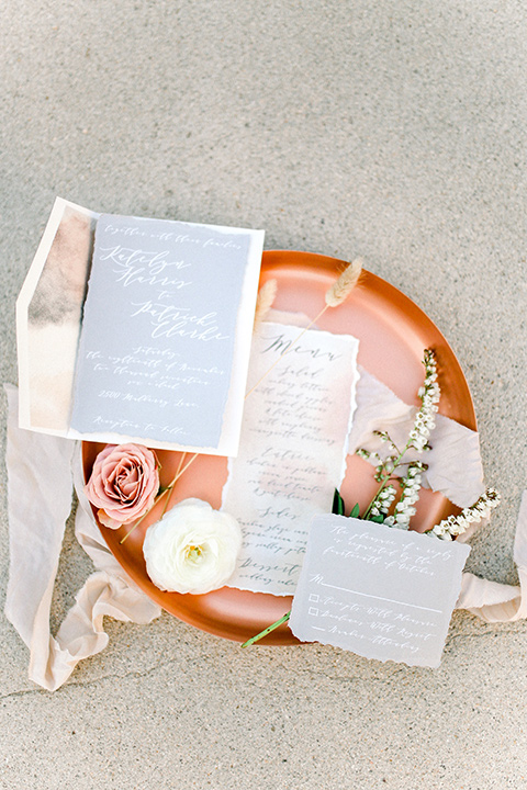 White and terracotta colored invitations