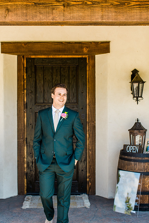 Topa-Winery-Wedding-groom-standing-in-a-green-suit-with-a-tan-long-tie-with-brown-shoes