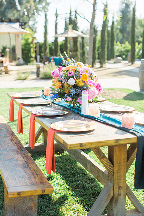 Topa-Winery-Wedding-table-set-up-with-picnic-tables-and-bright-colors-décor-with-gold-plates-and-flatware