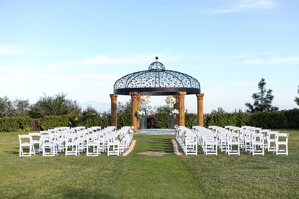 Vellano-Country-Club-ceremony-space-with-big-gazebo-and-white-chairs