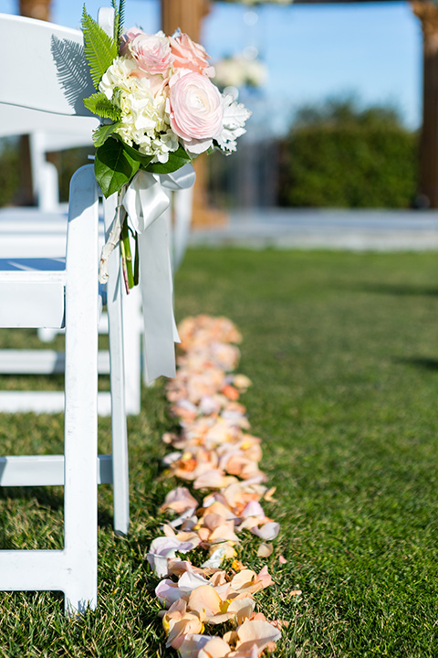 Vellano-Country-Club-chairs-at-ceremony-lined-with-rose-petals