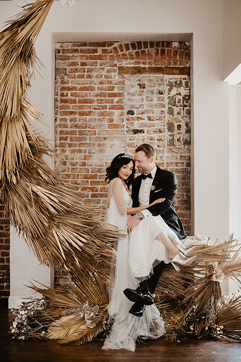 The-Yost-Theatre-bride-and-groom-by-moon-design-bride-in-a-modern-silk-gown-with-a-sheer-beaded-overlay-groom-in-a-black-velvet-tuxedo