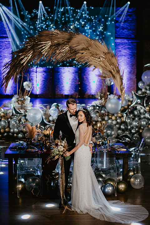 The-Yost-Theatre-bride-and-groom-with-theater-spacce-and-balloons-bride-in-a-modern-gown-with-jeweled-detailing-groom-in-a-velvet-tuxedo