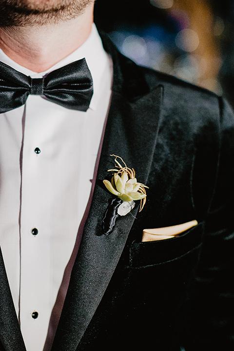 The-Yost-Theatre-close-up-on-groom-attire-in-a-modern-black-velvet-tuxedo