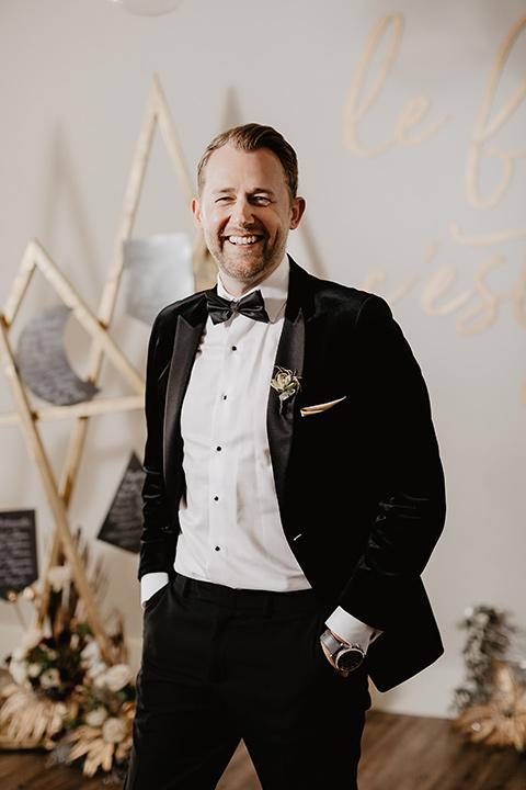 The-Yost-Theatre-groom-smiling-alone-groom-in-a-velvet-tuxedo