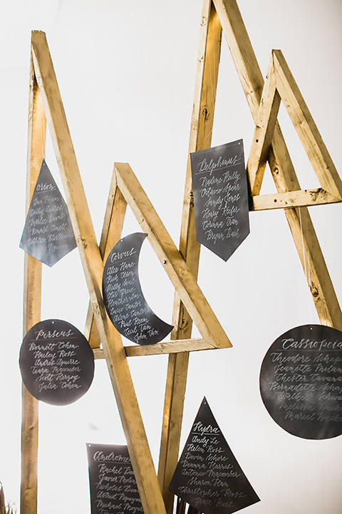 The-Yost-Theatre-table-seating-cards-in-black-geometric-shapes-and-gold-lettering