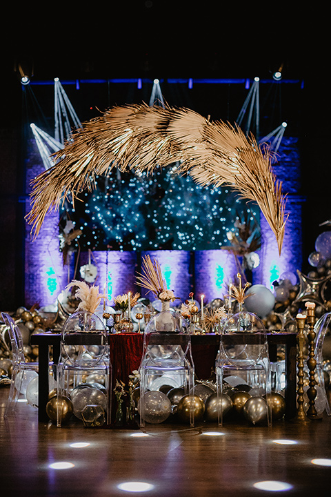 The-Yost-Theatre-table-set-up-with-gold-and-silver-balloons-and-modern-clear-furniture