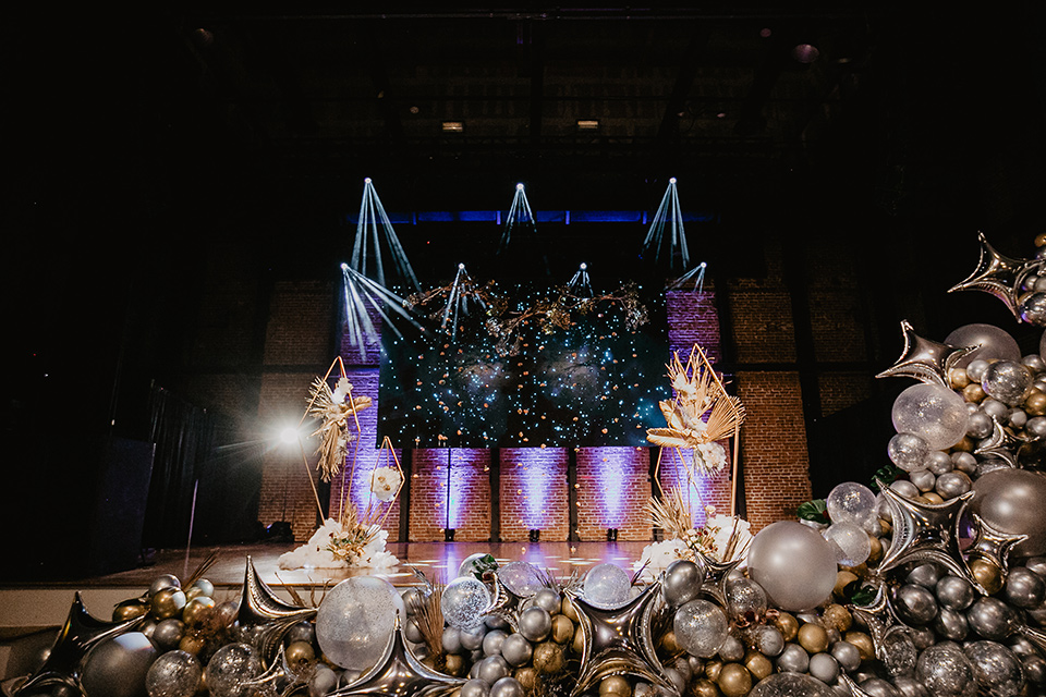 The-Yost-Theatre-theather-space-with-gold-and-silver-balloons-and-fun-bright-lighting
