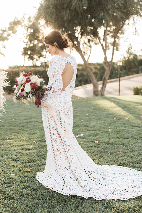 Temecula-outdoor-wedding-at-callaway-winery-bride-holding-bouquet-back-of-dress
