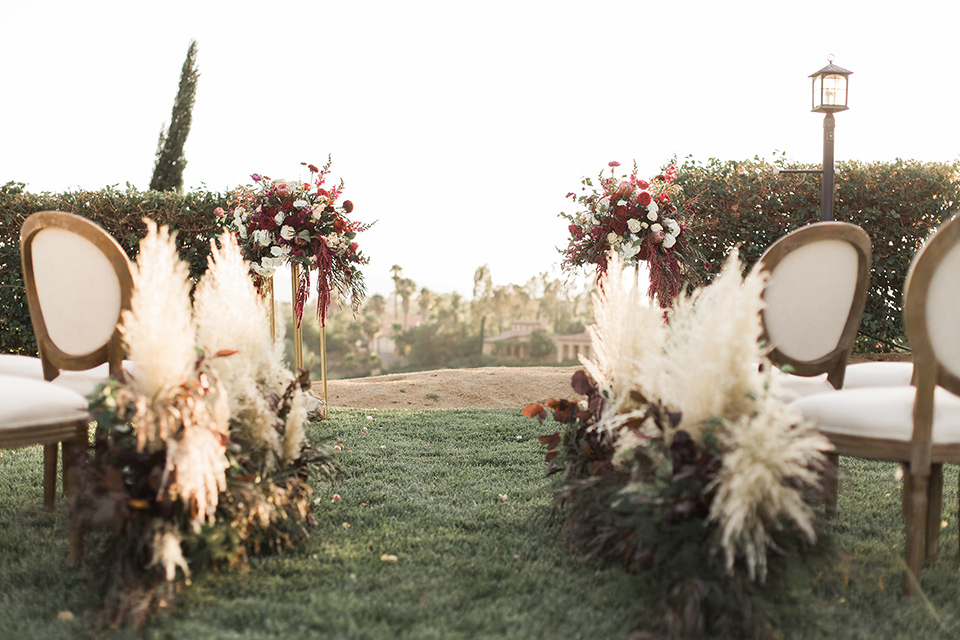 Temecula-outdoor-wedding-at-callaway-winery-ceremony-décor-with-feather-grass-detailing