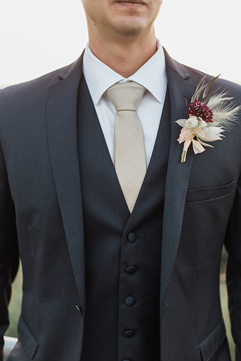 Temecula-outdoor-wedding-at-callaway-winery-groom-navy-suit-with-tie