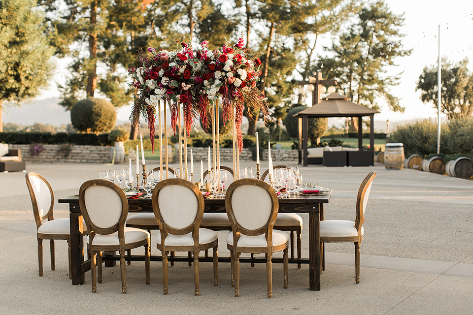 Temecula-outdoor-wedding-at-callaway-winery-table-set-up-with-dee-red-and-maroon-florals