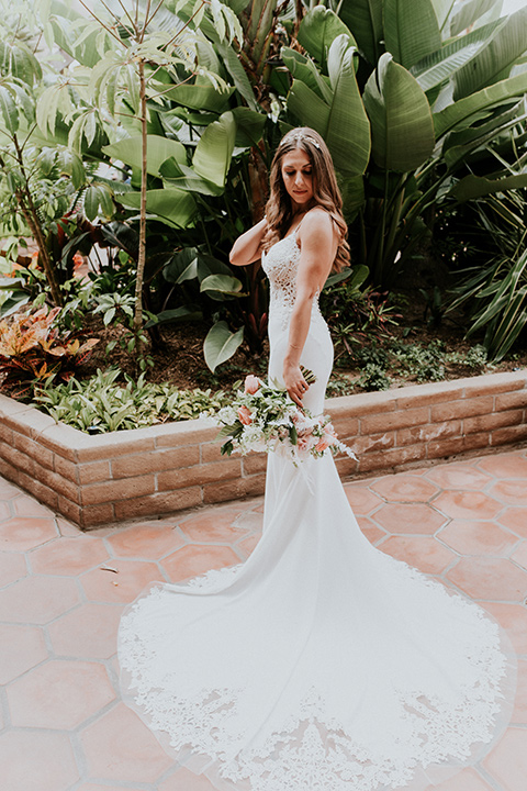 la-jola-shores-hotel-wedding-bride-looking-down-bride-in-a-satin-gown-with-a-silver-bodice-and-straps