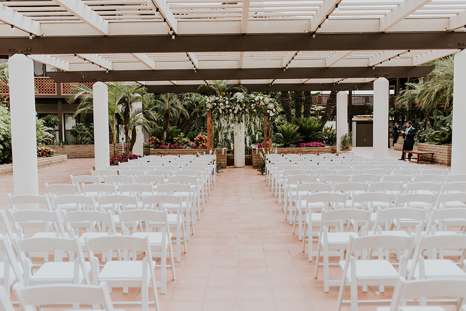 la-jola-shores-hotel-wedding-ceremony-set-up-with-white-chairs-and-a-wooden-archway