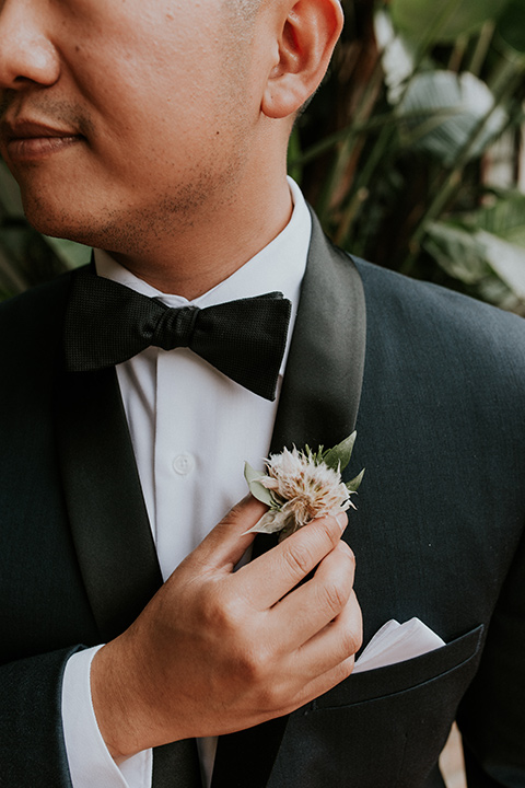 la-jola-shores-hotel-wedding-close-up-on-groom-with-a-navy-shawl-lapel-tuxedo-with-black-trim