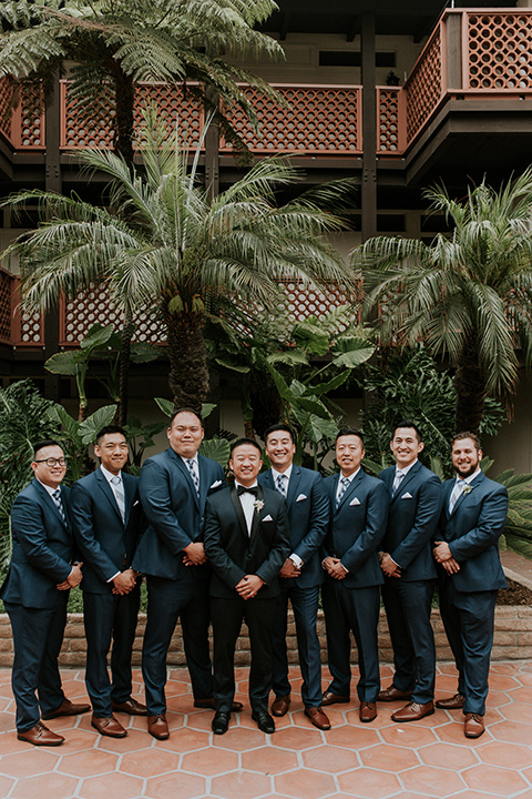 la-jola-shores-hotel-wedding-groomsmen-standing-smiling-at-camera-with-navy-suits-on