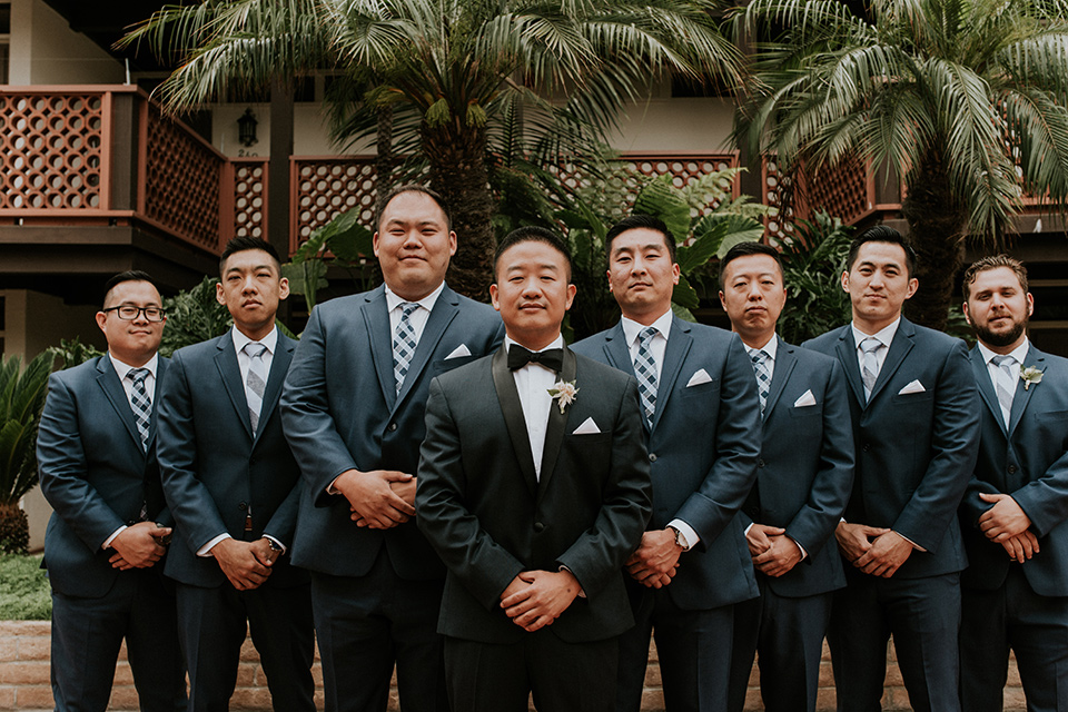 la-jola-shores-hotel-wedding-groomsmen-in-dark-blue-tuxedos