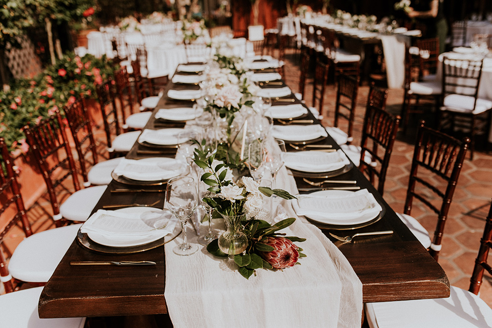 la-jola-shores-hotel-wedding-table-set-up-with-wooden-tables-and-whtie-linens