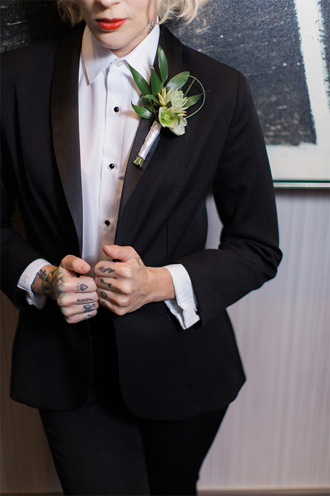 Black-shawl-lapel-female-tuxedo-styled-with-a-white-tuxedo-shirt-black-studs-and-cufflinks-and-no-neckwear