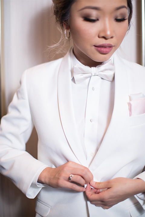white-female-tuxedo-with-a-white-shirt-white-vest-and-white-bow-tie
