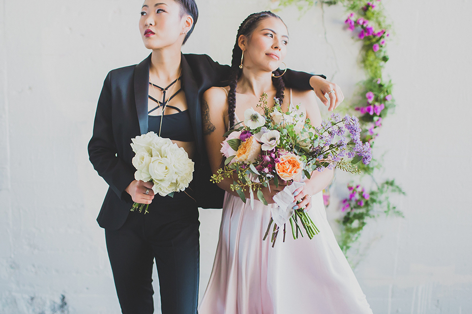Los-angeles-same-sex-wedding-shoot-brides-hugging-and-holding-bouquet
