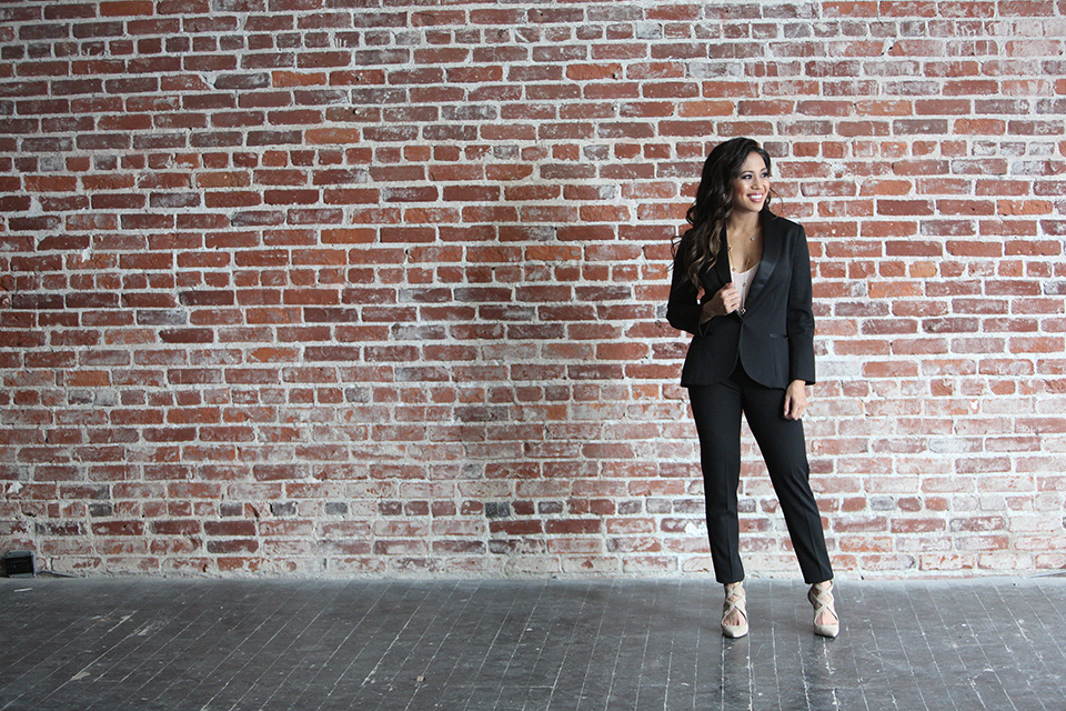 female-model-in-front-of-a-brick-wall-wearing-a-black-shawl-lapel-tuxedo