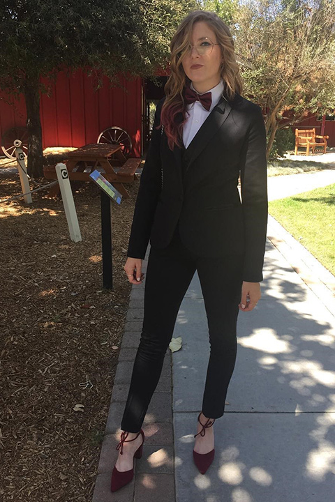 girl-wearing-tuxedo-as-a-groomsman-in-ceremony-wearing-a-black-shawl-lapel-tuxedo