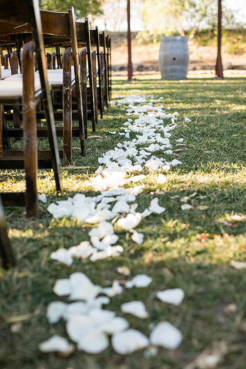 gallway-downs-wedding-ceremony-chairs-and-white-rose-petals-on-the-floor