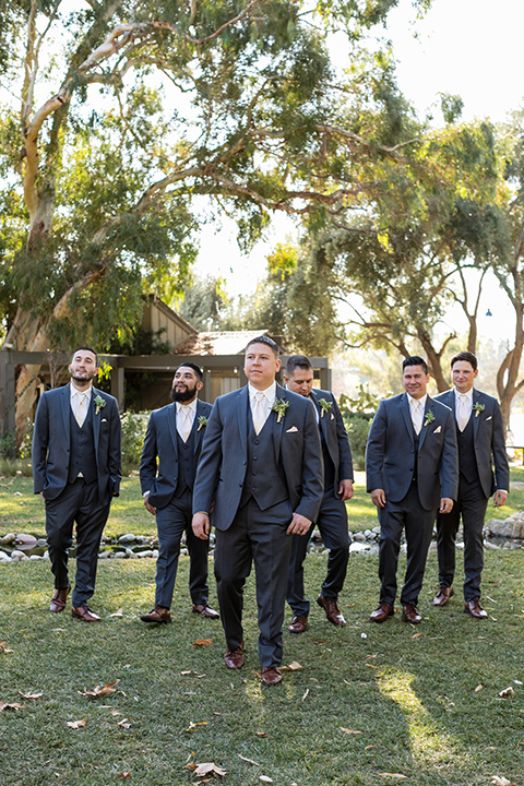 gallway-downs-wedding-groomsmen-walking-in-charcoal-tuxedos-and-neutral-color-ties
