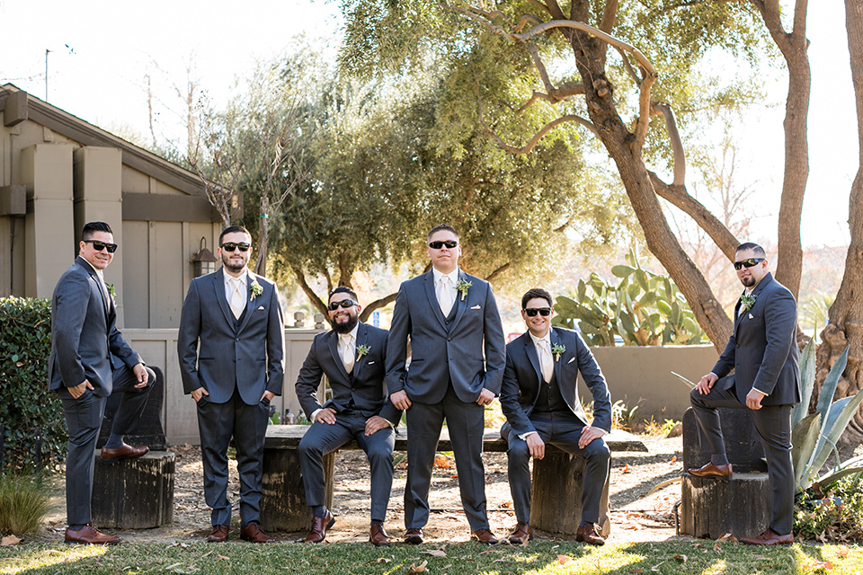 gallway-downs-wedding-groomsmen-groom-in-a-charcoal-tux-withan-ivory-long-tie-groom-in-a-charcoal-grey-tuxedo-with-a-blush-tie-and-his-groomsmen-matching