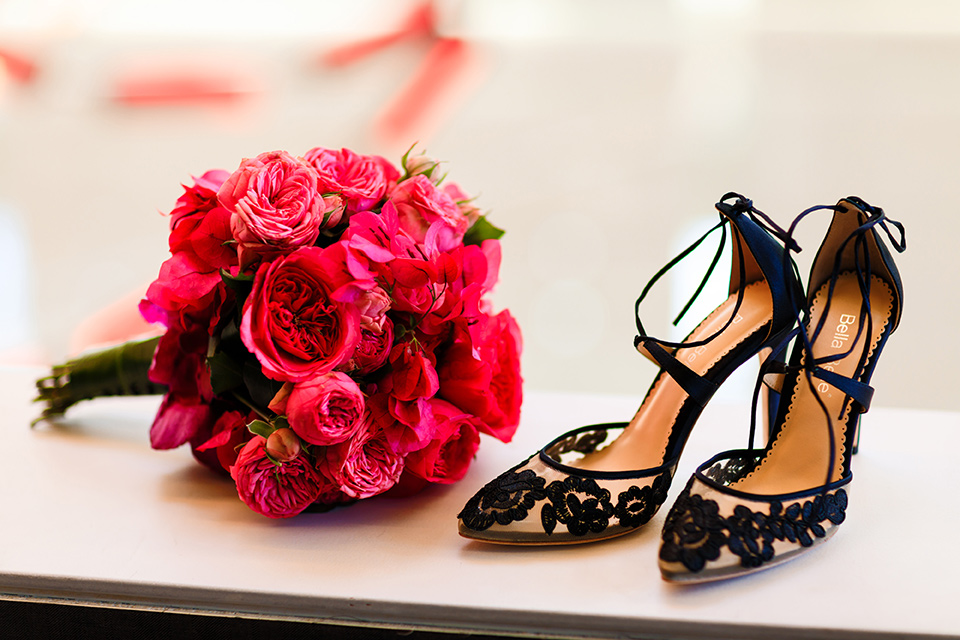 Intercontinental-DTLA-shoot-bridal-accessories-shot-with-the-bridal-shoes-with-black-lace-detailing-and-red-rose-bouquet