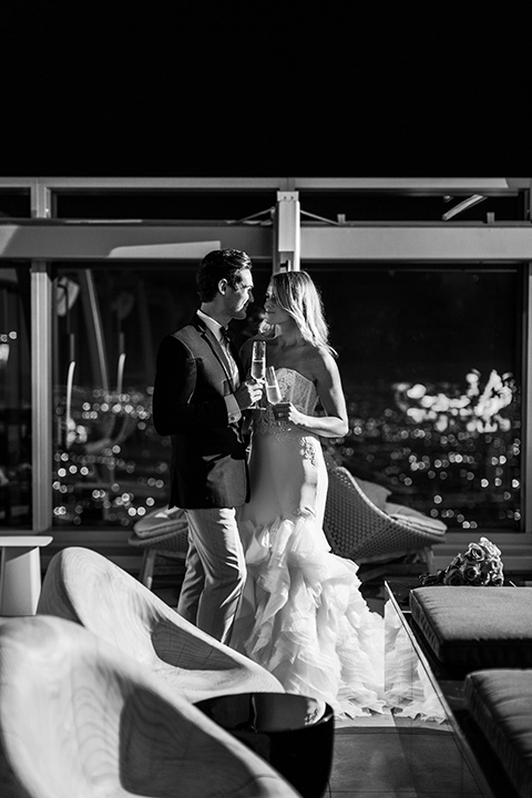 Intercontinental-DTLA-shoot-bride-and-groom-black-and-white-photo-with-champagne