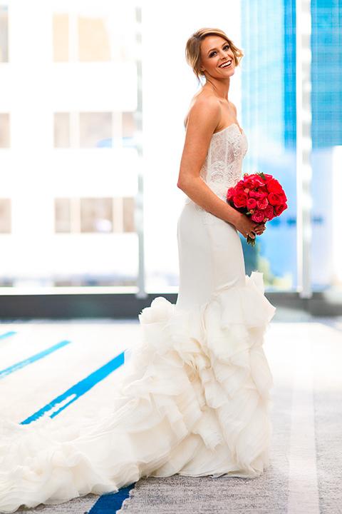 Intercontinental-DTLA-shoot-bride-standing-holding-her-bouquet-in-a-strapless-dress