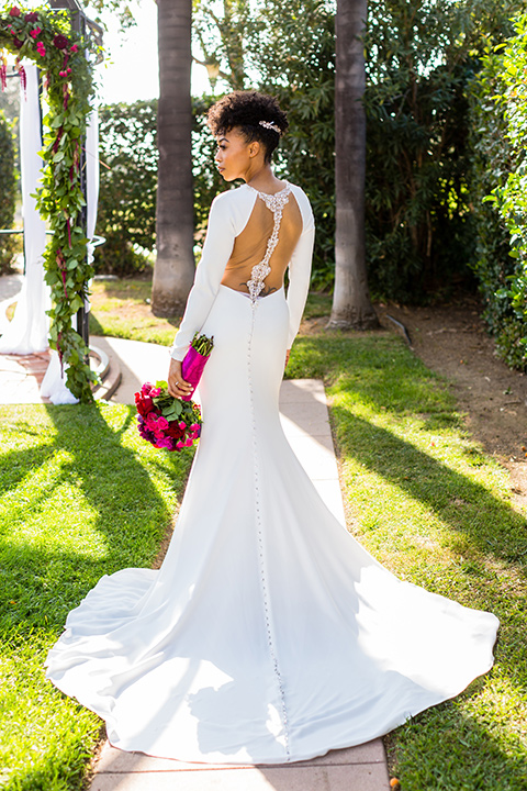 muckenthaler-mansion-bride-alone-in-a-long-white-satin-gown-with-sleeves