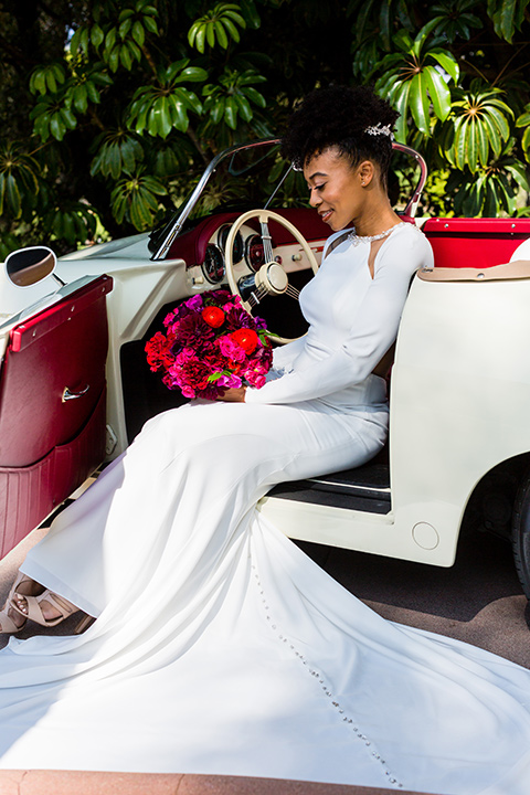 muckenthaler-mansion-bride-sitting-in-car-in-a-sating-white-gown-and-long-sleeves