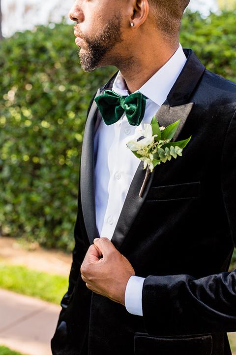 muckenthaler-mansion-close-up-on-groom-look-groom-in-a-black-velet-tux