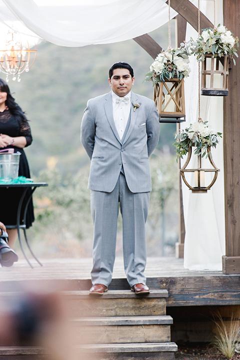hidden-acres-wedding-groom-waiting-for-bride-groom-in-light-grey-suit
