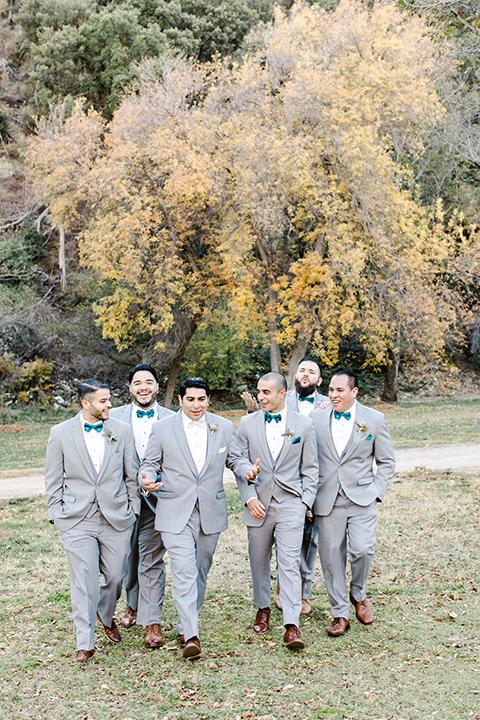 hidden-acres-wedding-groomsmen-walking-all-in-light-grey-suits