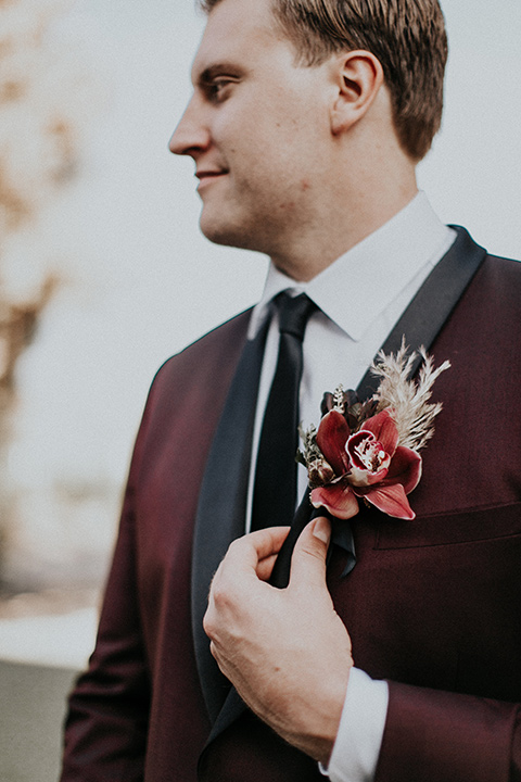 orange-county-vow-renewal-groom-alone-groom-in-a-burgundy-tuxedo-with-a-black-shawl-lapel