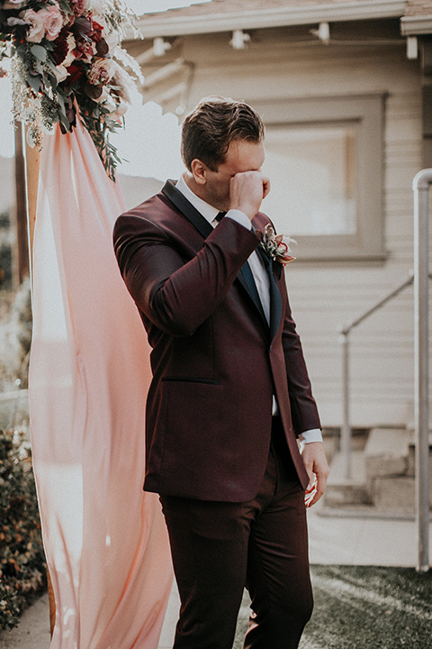 orange-county-vow-renewal-groom-crying-groom-in-a-burgundy-tuxedo-with-a-black-shawl-lapel