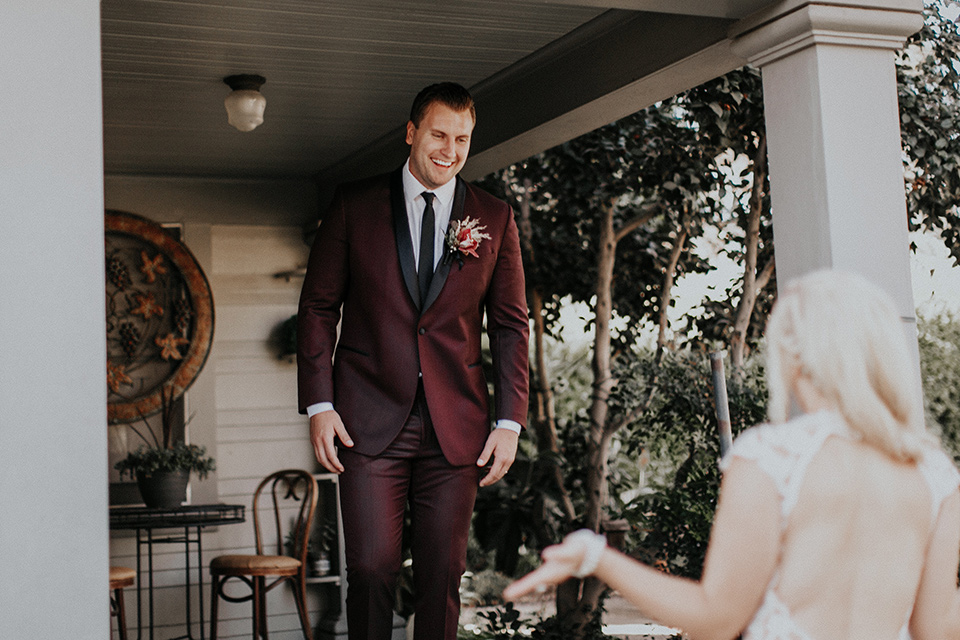 orange-county-vow-renewal-groom-seeing-bride-bride-in-a-lace-modern-fitted-gown-with-a-nude-underlay-groom-in-a-burgundy-tuxedo-with-a-black-shawl-lapel