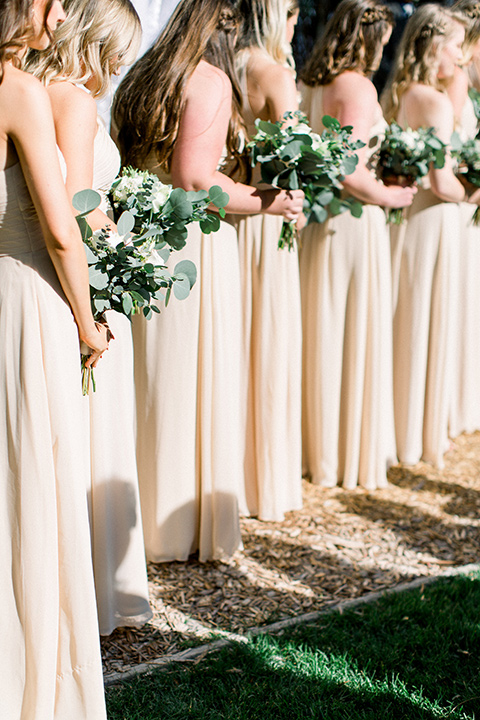 bridesmaids in neutral long gowns
