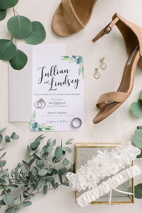 white invitations with greenery decor