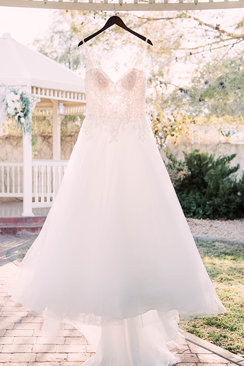 little-chapel-on-the-corner-las-vegas-wedding-shoot-bridal-gown-hanging-outside-it-is-a-full-tulle-ballgown