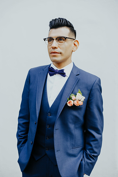 loquita-shoot-groom-1-hands-in-pocket-groom-in-cobalt-blue-suit-with-blue-bow