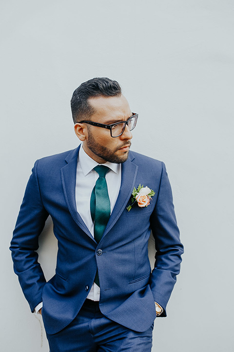 loquita-shoot-groom-2-hands-in-pockets-groom-in-cobalt-blue-suit-with-green-long-tie