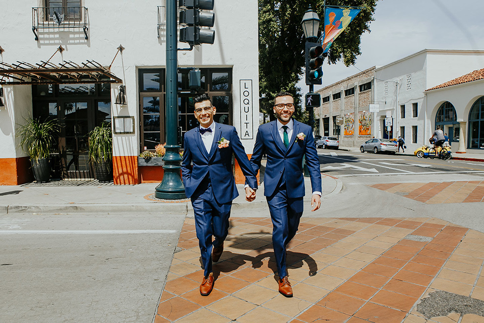 loquita-shoot-grooms-crossing-the-street-grooms-in-cobalt-blue-suits-with-one-with-a-green-tie-and-the-other-with-a-blue-bow