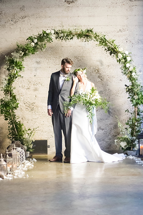 luce-loft-ceremony-bride-in-a-fit-and-flare-gown-with-straps-groom-in-a-charcoal-suit-with-champagne-bow-tie