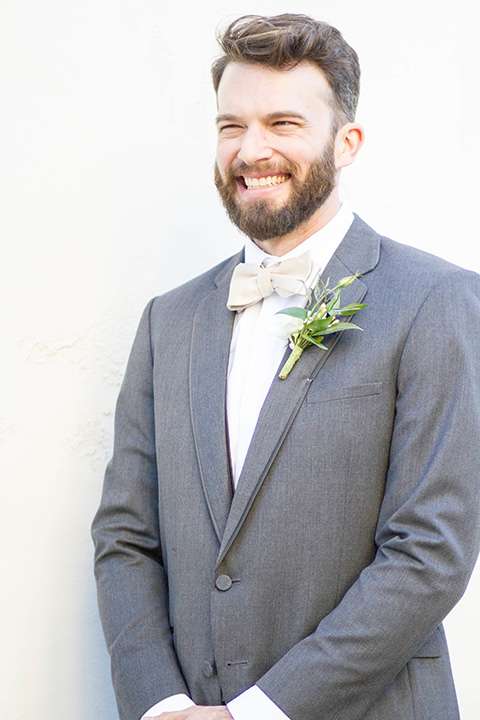 luce-loft-groom-alone-close-up-groom-in-a-charcoal-suit-with-champagne-bow-tie